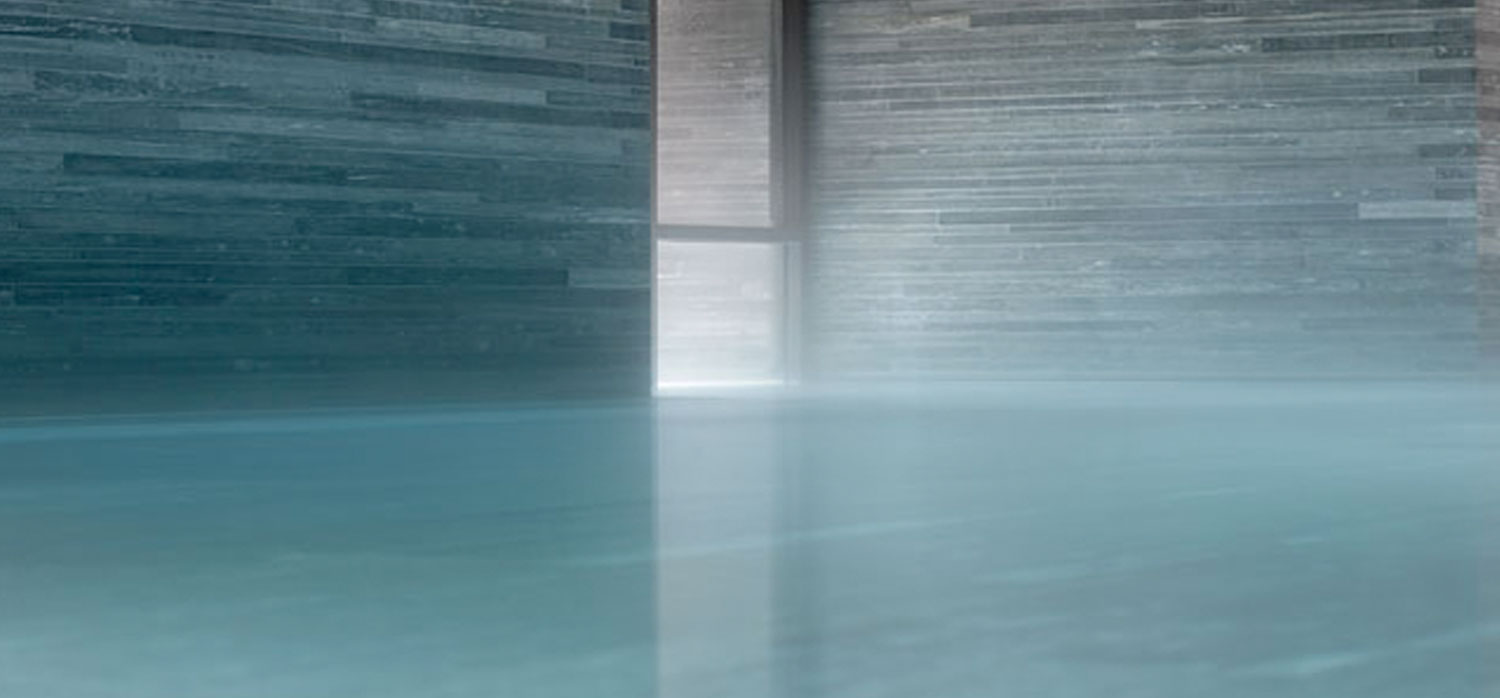 Zumthor's passion for materials, craftsmanship, and sensory experience can be seen throughout his work. The Therme Vals in Switzerland allows guests to experience all these dimensions when they soak in an architectural masterpiece.  photo courtesy Therme Vals