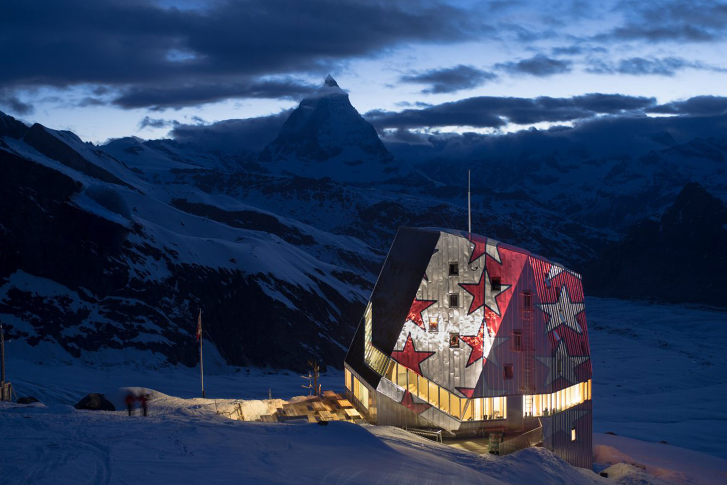 Global warming affecting mountains and glaciers is one of the Swiss Alpine Club's biggest challenges according to its president, Françoise Jaquet. The Monte Rosa Hut (9,458 feet) owned by the Club, covers 90% of its energy needs with photovoltaic solar cells on the roof and temperature sensors.